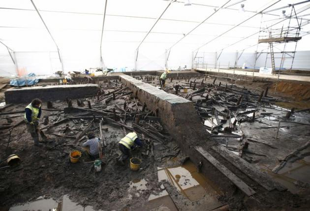 Archaeologists from the University of Cambridge Archaeological Unit, uncovering Bronze Age wooden houses, preserved in silt, from a quarry near Peterborough